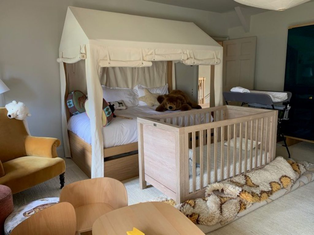 Trundle bed made up with canvas drapes